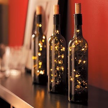 a lamp of string lights stuffed into a wine bottle