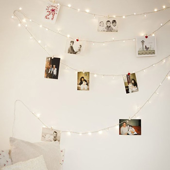 photos pinned to string lights